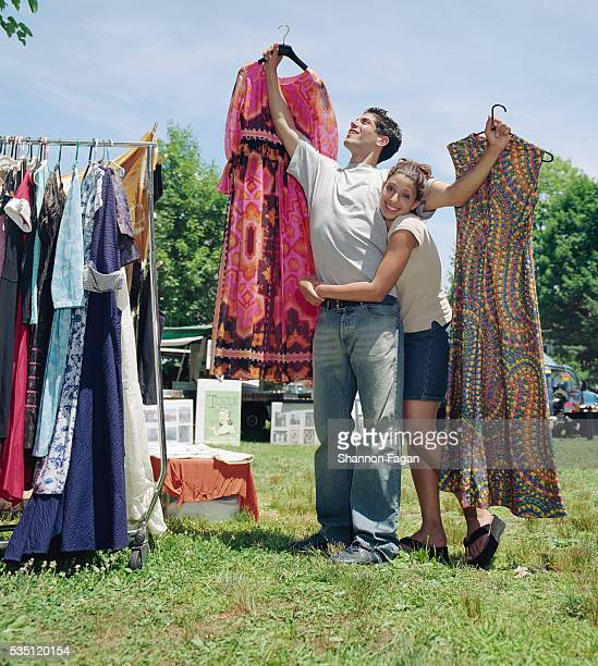 Couple Choosing Clothes at Yard Sale