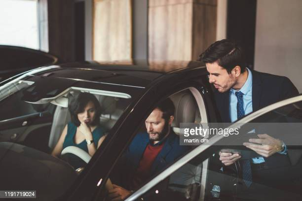 couple choosing new car - test drive stock pictures, royalty-free photos & images