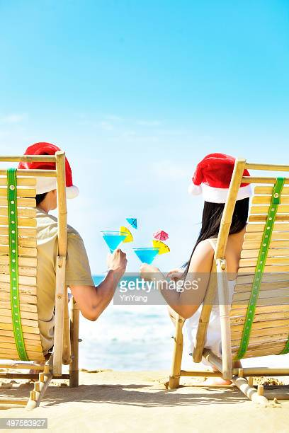 couple christmas vacation in tropical beach vertical - hawaii christmas stock pictures, royalty-free photos & images