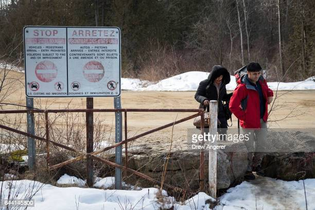 A couple claiming to be from Turkey cross the USCanada border into Canada February 23 2017 in Hemmingford Quebec Canada In the past month hundreds of...