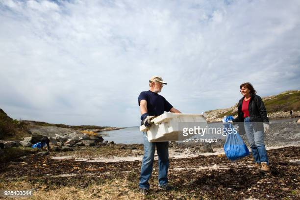 Couple cleaning coast