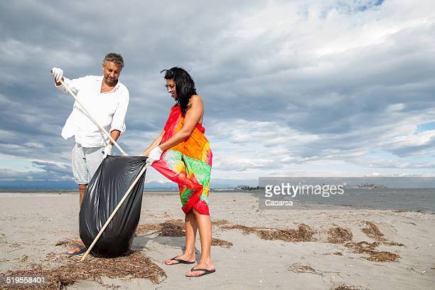 Couple cleaning the beach