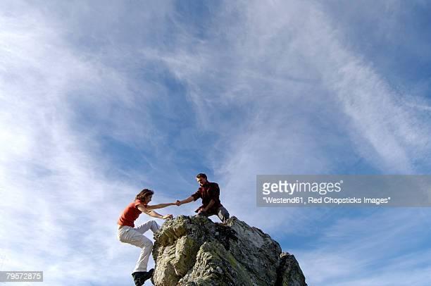 Couple climbing on summit