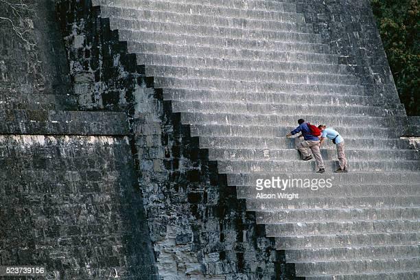 Couple Climbing Steps of Pyramid