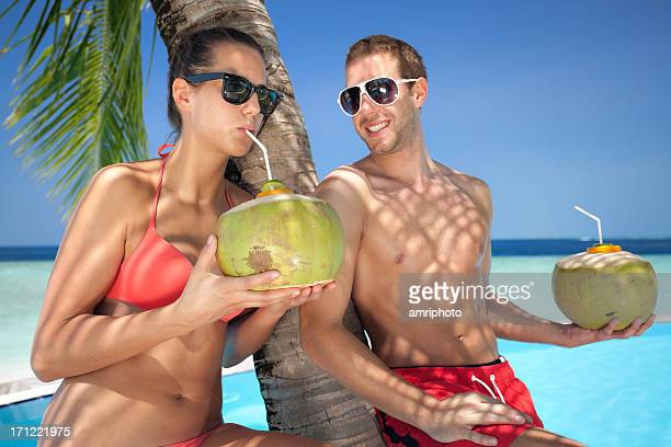 couple coconut drink pool