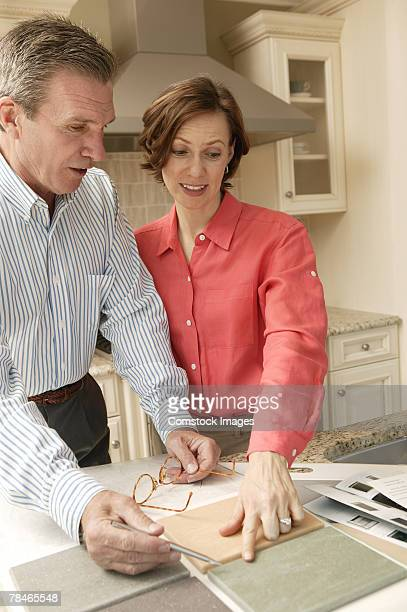 Couple comparing kitchen tiling