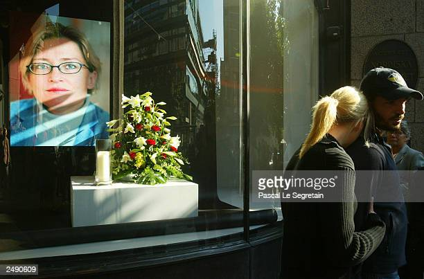 A couple console each other in front of the department store where Swedish Foreign Minister Anna Lindh was stabbed on September 13 2003 in...