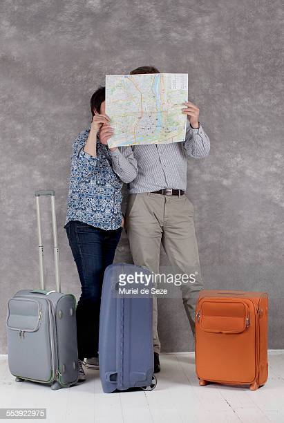 Couple consulting city map