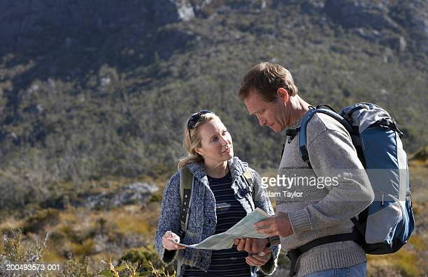 Couple consulting map on hike