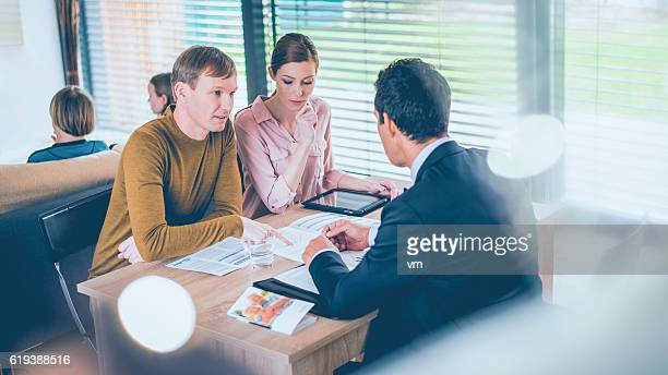 Couple consulting their insurance agent