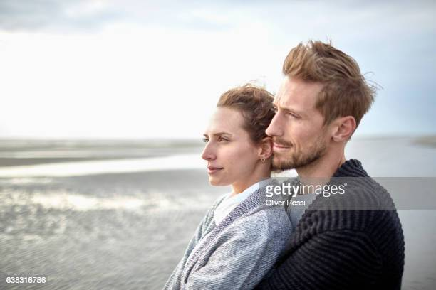 Couple contemplating on the beach