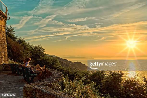 Couple Contemplating The Sunset And The Sea From The Mountain Igueldo, Spain