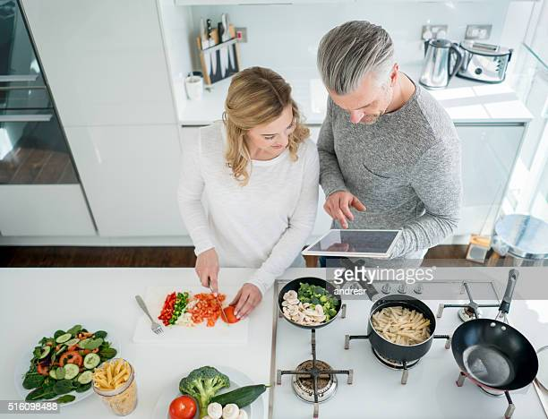 Couple cooking dinner at home