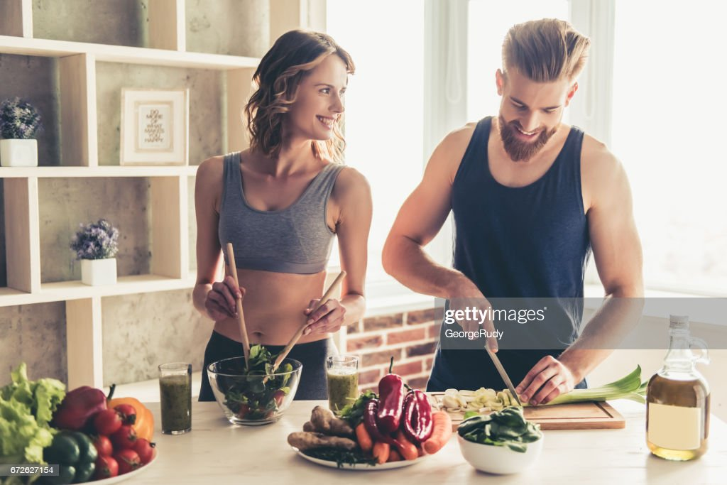 Couple cooking healthy food : Stock Photo