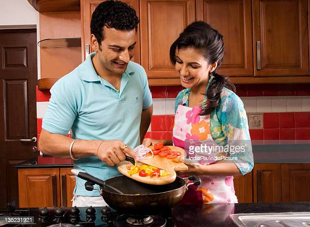Couple cooking in the kitchen together
