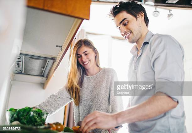 couple cooking - doing a favor stock pictures, royalty-free photos & images