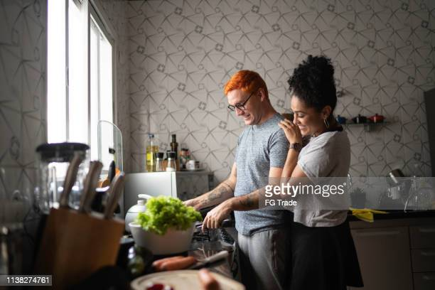 couple cooking together at home - hipster culture stock pictures, royalty-free photos & images