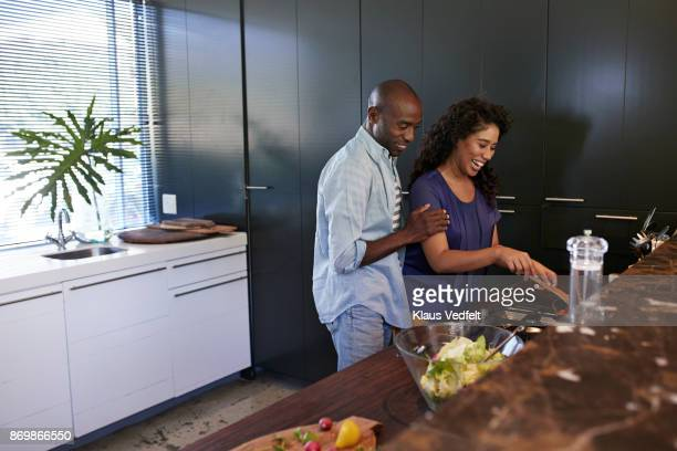 Couple cooking together in the kitchen