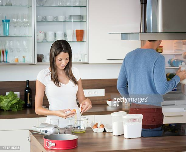 couple cooking together - women whipping men stock photos and pictures