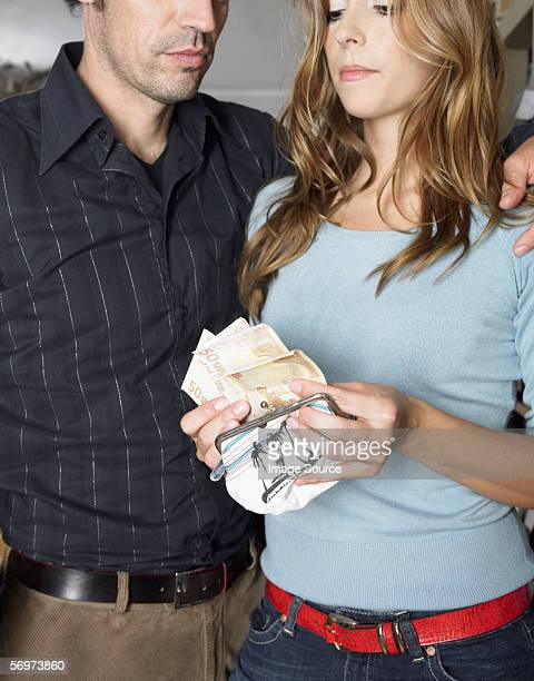 Couple counting bank notes