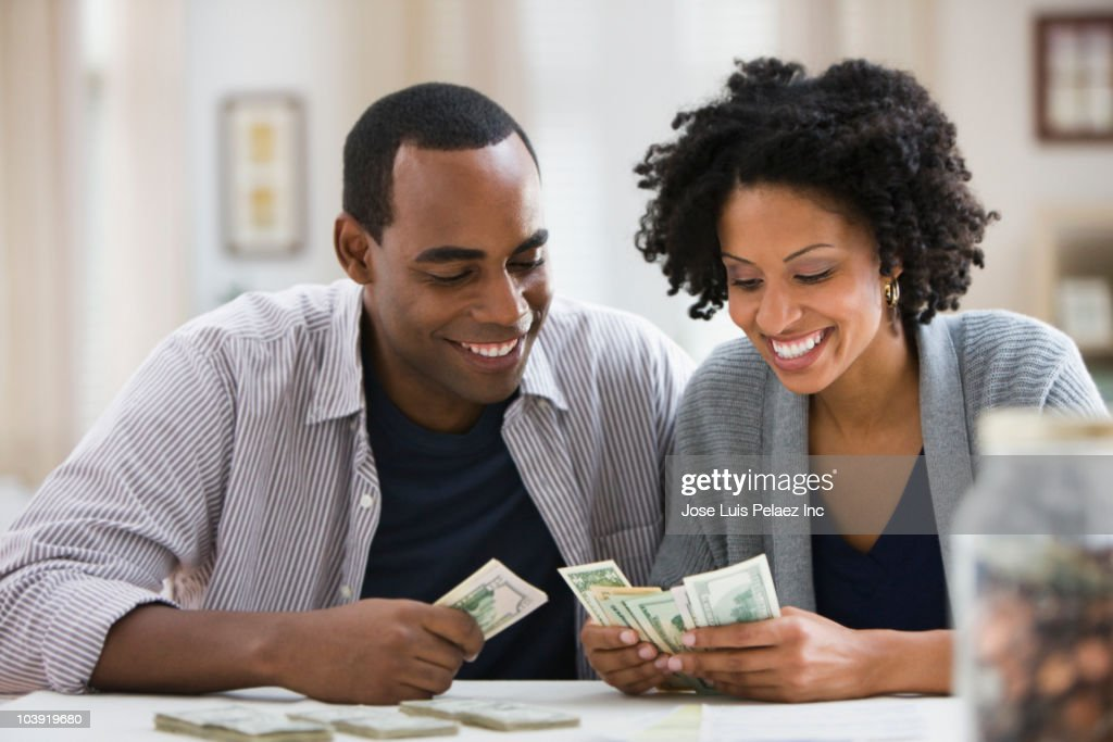 Couple counting money : Stock Photo
