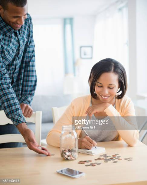 Couple counting savings at table
