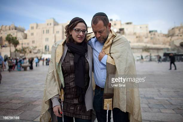A couple covered with a 'Tallit' pray as member of the religious group 'Women of the Wall' pray at the Western Wall on April 11 2013 in Jerusalem's...