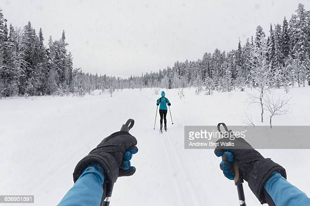 Couple cross country skiing on a winter trail