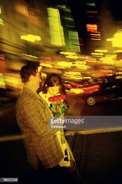 couple crossing city street - thinkstock stock photos and pictures