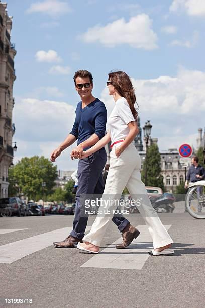 Couple crossing the road, Paris, Ile-de-France, France