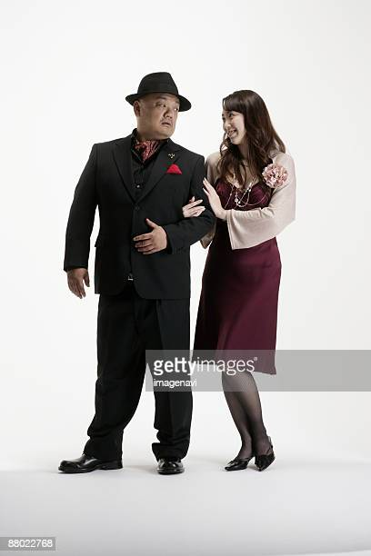 a couple crossing their arms - metabolic syndrome stock pictures, royalty-free photos & images