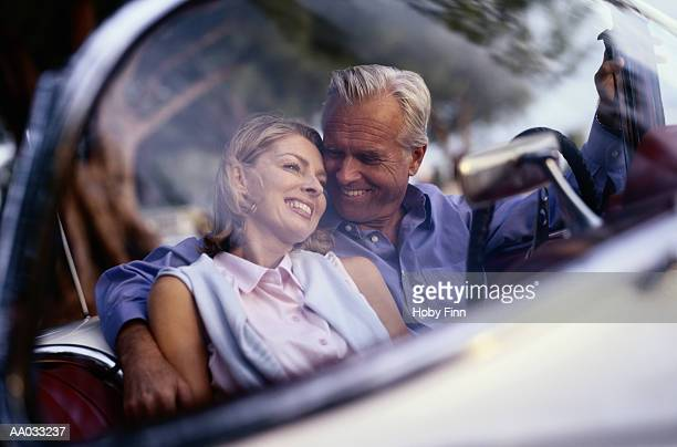Couple Cuddling in a Convertible