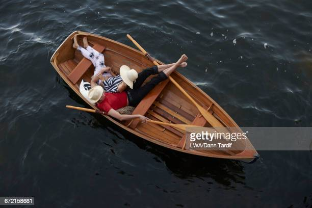 Couple cuddling in rowboat