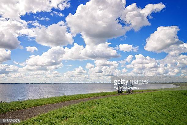 Couple Cycling on a Dike