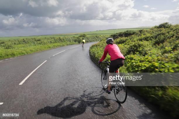 Couple cycling on coastal road