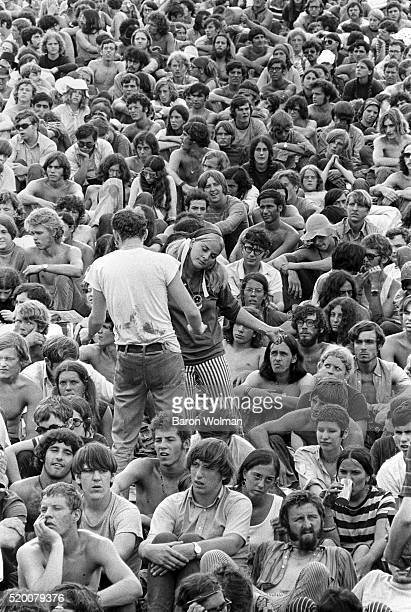 A couple dance amongst the crowd at Woodstock Music Art Fair Bethel NY August 15 1969