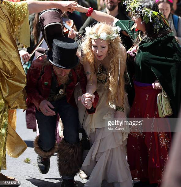 A couple dance as they take part in a Beltane May Day celebration in Glastonbury main street on May 1 2013 in Glastonbury England Although more...