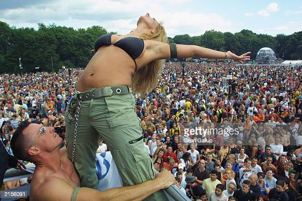 A couple dance on top of a truck blaring techno music to thousands of ravers July 12 2003 at the annual Loveparade in Berlin Germany Hundreds of...