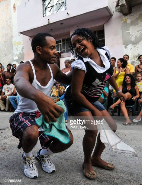 A couple dance Rumba in a street of Havana on August 22 2018 The Rumba a mix of African and Spanish culture considered by UNESCO an Intangible...