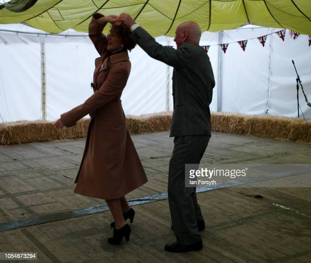 A couple dance to swing music during the North Yorkshire Moors Railway 1940's Wartime Weekend event on October 14 2018 in Pickering England The...