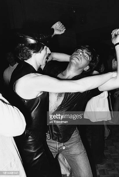 Couple dance together in a disco in Midtown Manhattan, New York City, 1979.