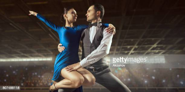 couple dancers ardently perform the latin american dance on a large professional stage - ukrainian angel stock photos and pictures