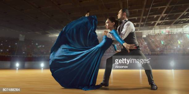 couple dancers ardently perform the latin american dance on a large professional stage - rumba stock photos and pictures