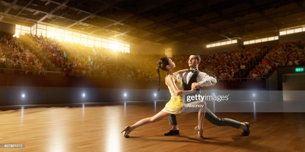 Couple dancers ardently perform the latin american dance on a large professional stage : Stock Photo