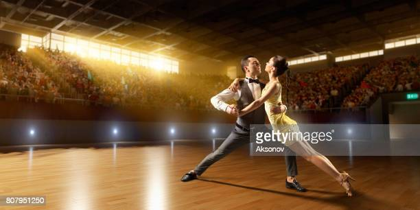 couple dancers ardently perform the latin american dance on a large professional stage - cha cha stock photos and pictures