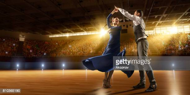 Couple dancers ardently perform the latin american dance on a large professional stage