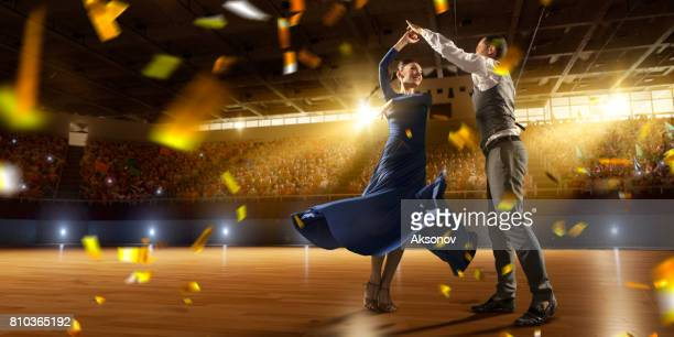 couple dancers ardently perform the latin american dance on a large professional stage with sparkle fireworks - arte, cultura e espetáculo imagens e fotografias de stock