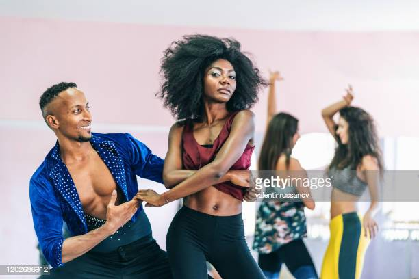 couple dancers practicing in studio, holding hands - samba stock pictures, royalty-free photos & images