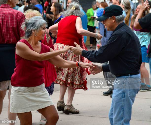 A couple dances during a live music concert in the historic Plaza in Santa Fe New Mexico