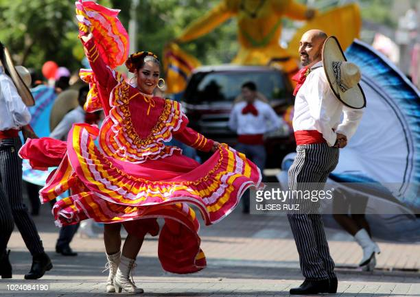 Couple dances during the 25th International Mariachi Festival in Guadalajara, Mexico on August 26, 2018. - Mariachi music has been acknowledged by...